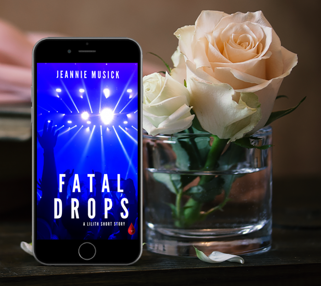 """Fatal Drops"" eBook on iphone with glass and rose"